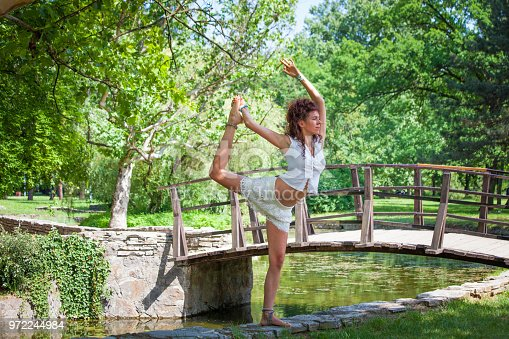 istock yoga instructor outdoor 972244984
