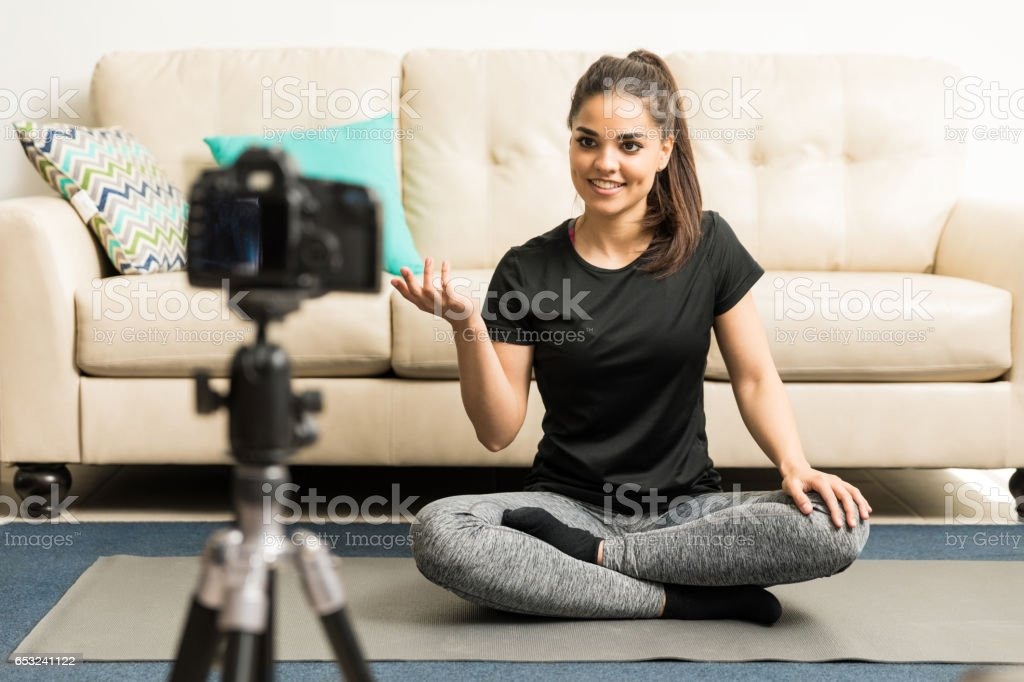 Yoga instructor recording a video stock photo