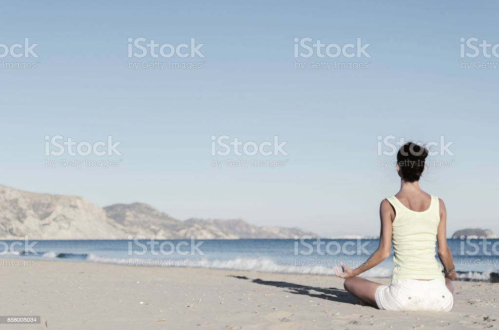 Yoga lady beach stock photo