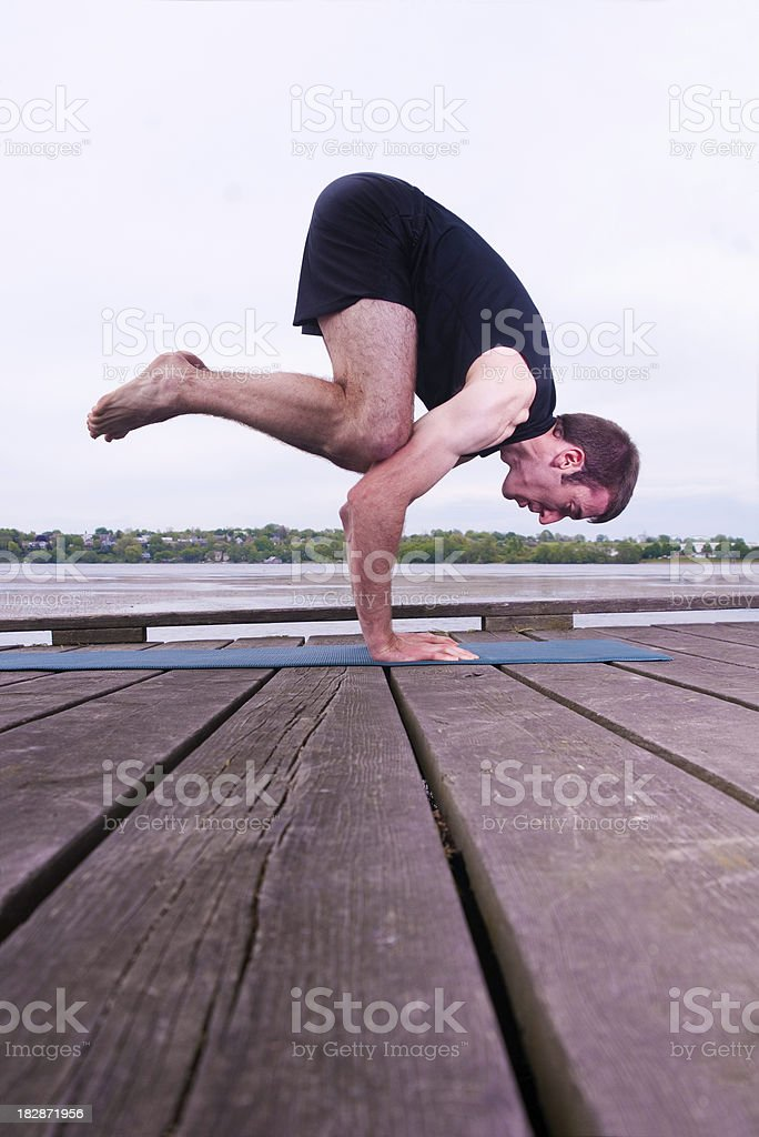 Yoga Man Series: Arm Balance by a Lake royalty-free stock photo