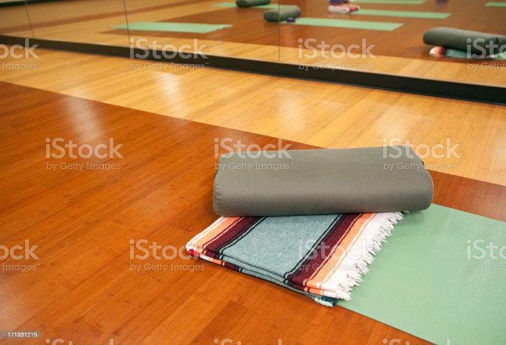Yoga mat, Blanket and Bolster on Studio Floor stock photo
