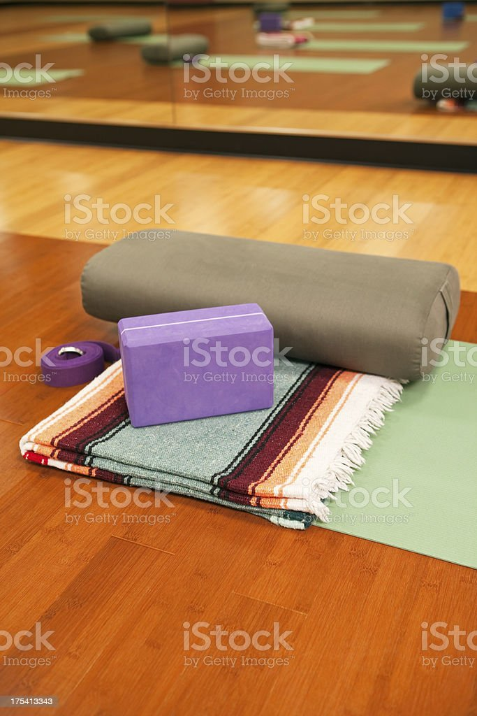 Yoga mat, Blanket, Bolster, Block and Strap on Studio Floor stock photo