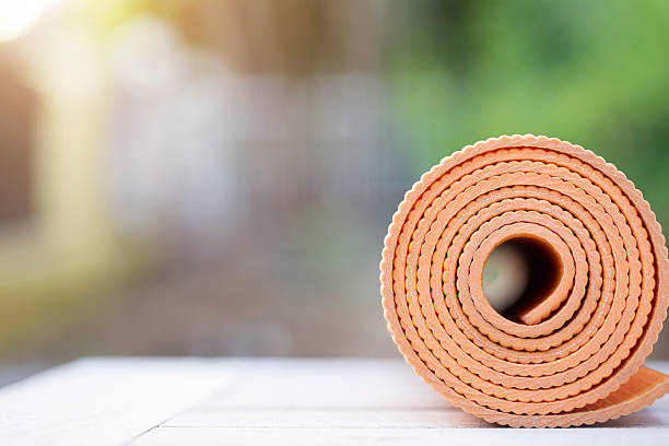 yoga mat on the table in a garden stock photo