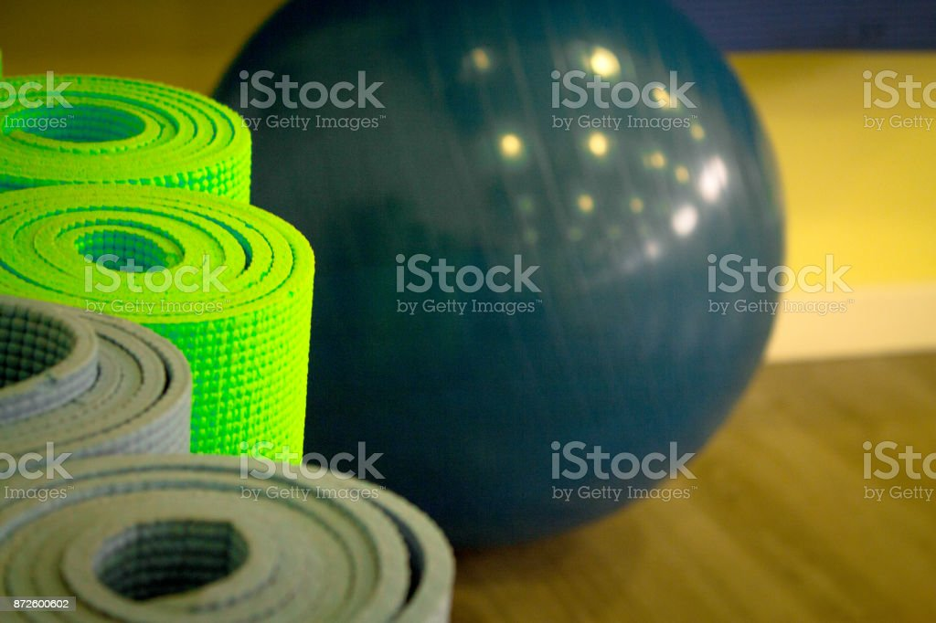 Yoga mat on wooden floor to perform meditation exercises stock photo