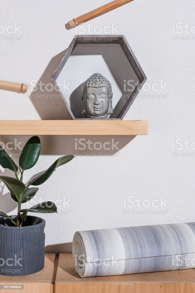 yoga mat under sculpture of buddha head in frame - Royalty-free Art Stock Photo