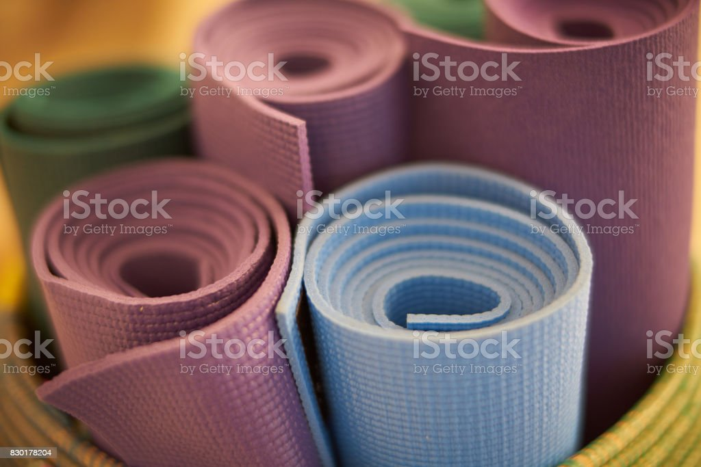 yoga mats in a basket stock photo