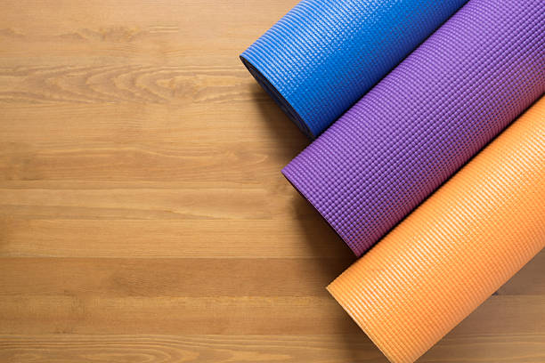 Yoga mats on the wood table stock photo