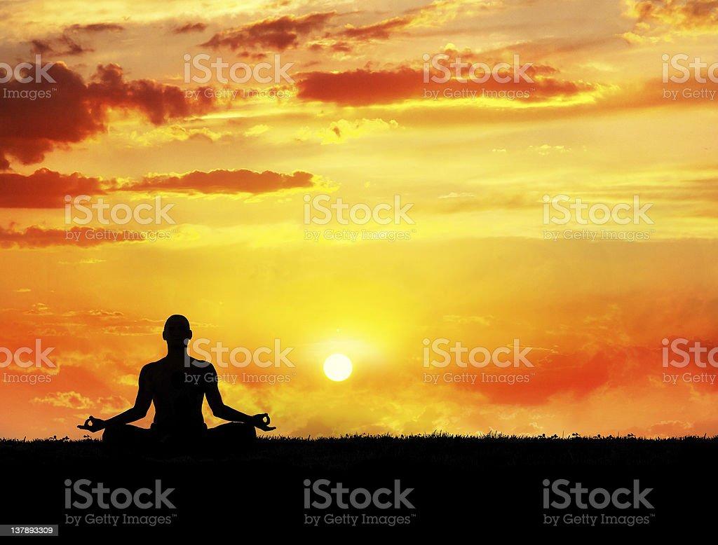 Yoga meditation at sunset royalty-free stock photo
