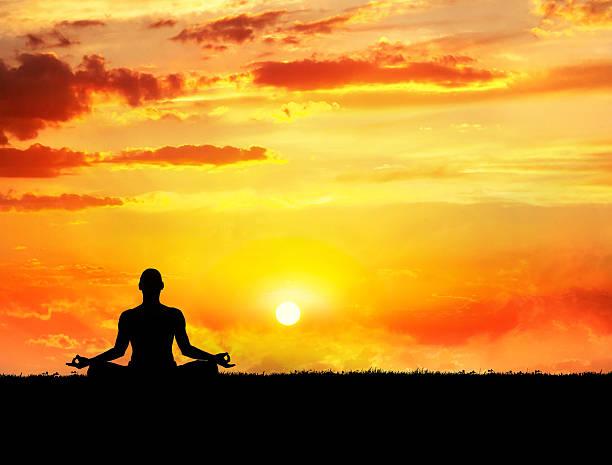 Yoga meditation at sunset stock photo