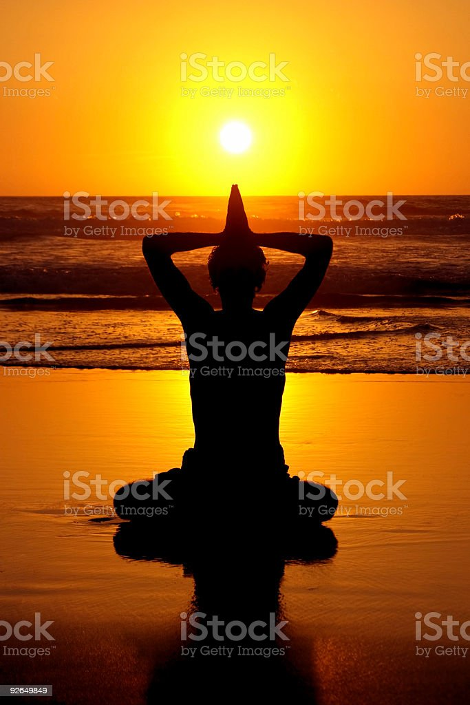 Yoga meditation at the atlantic ocean with sunset royalty-free stock photo