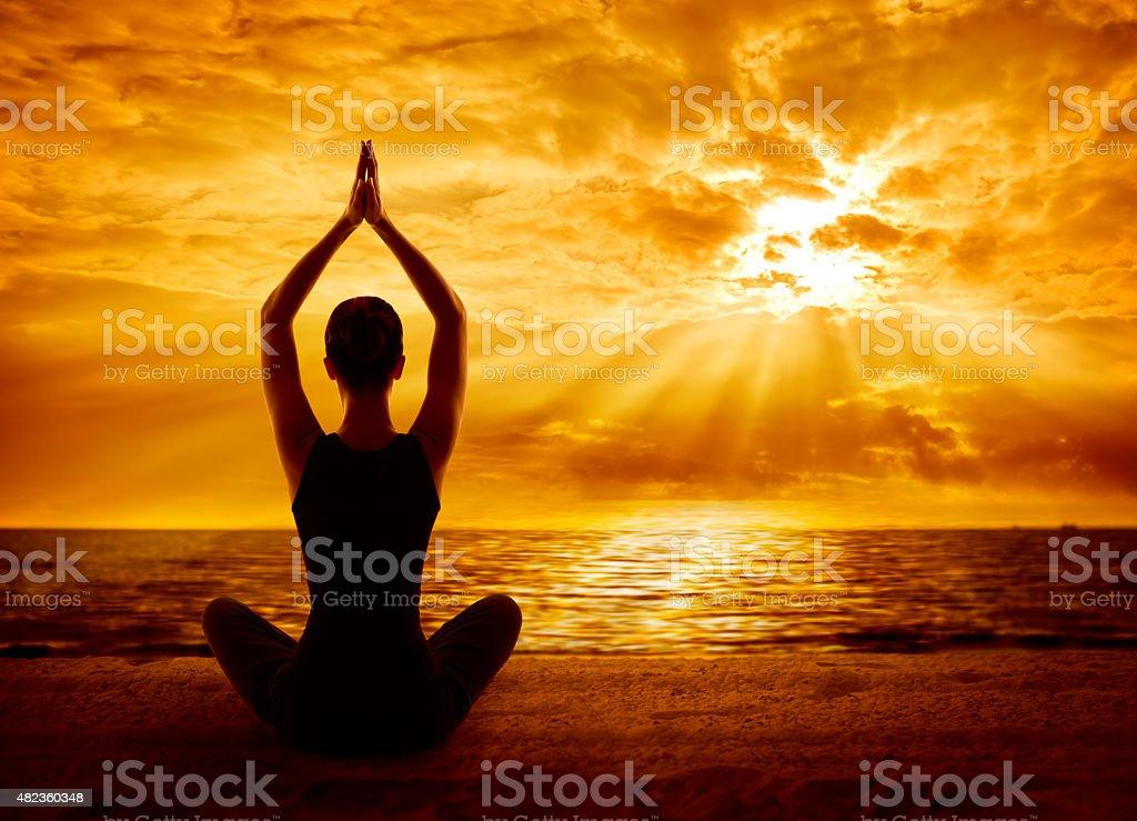 Yoga Meditation Concept, Woman Silhouette Meditating Healthy Pose, Sun Light stock photo