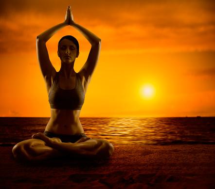 yoga meditation lotus pose woman meditating outdoor yoga