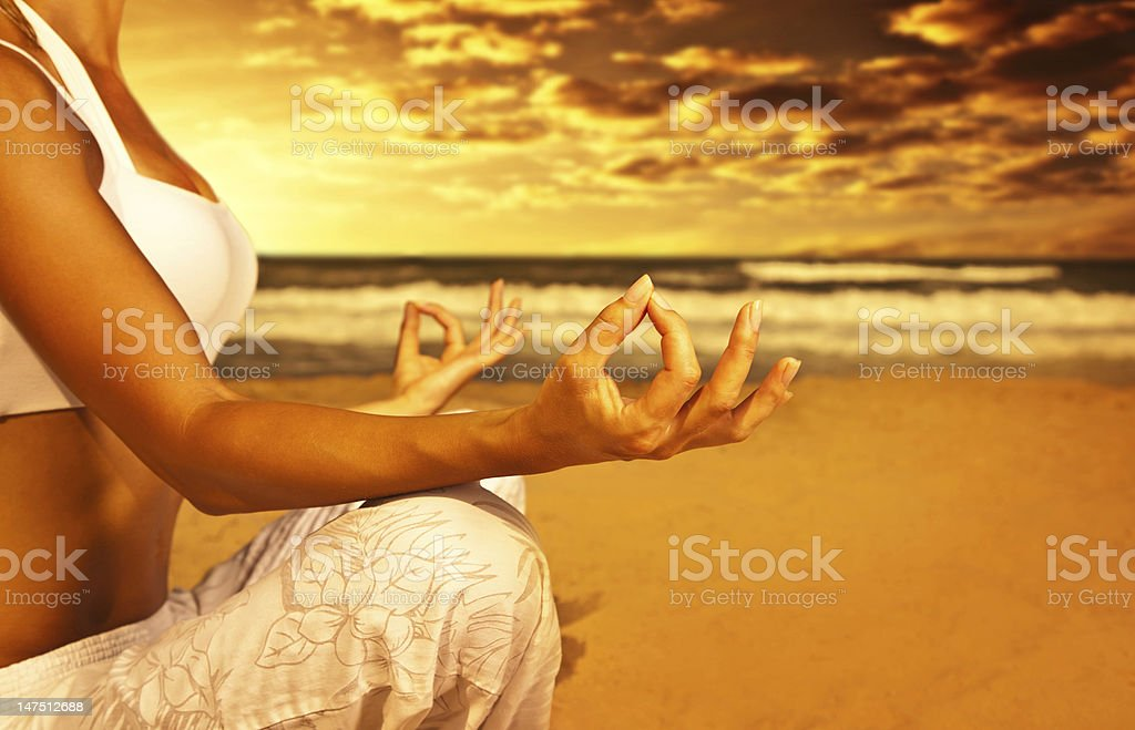 Yoga meditation on the beach royalty-free stock photo