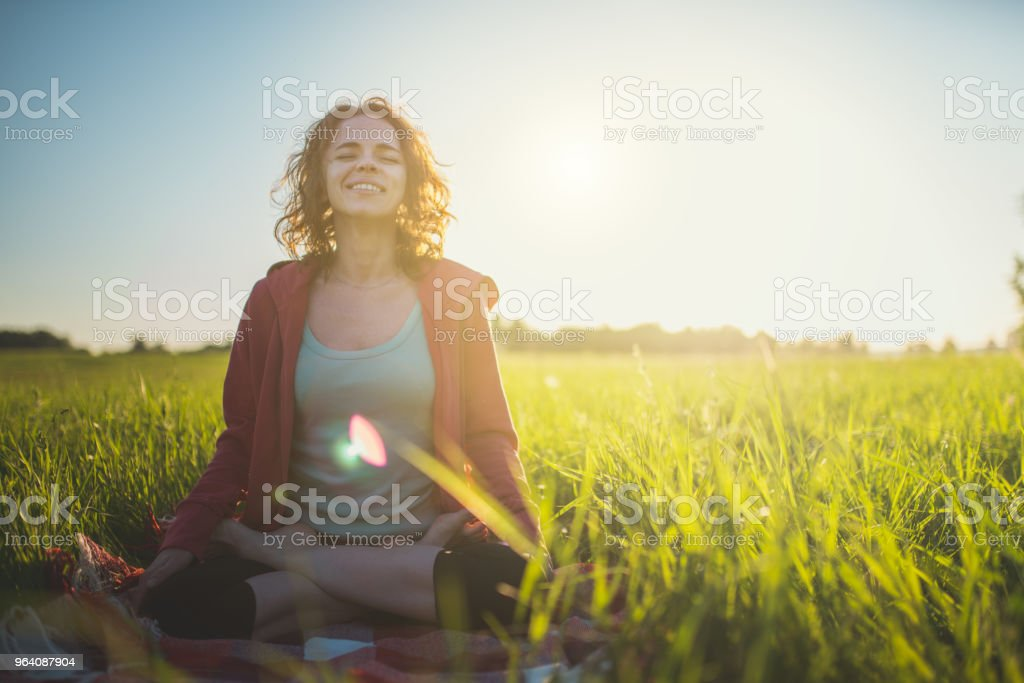 Yoga Meditation Outdoors in Lotus Position - Royalty-free Adult Stock Photo