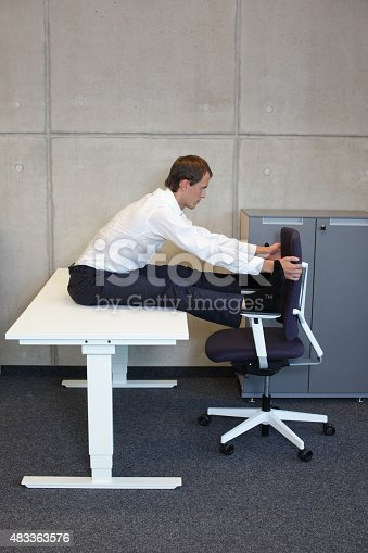 511849865 istock photo yoga office - man practicing at workplace 483363576