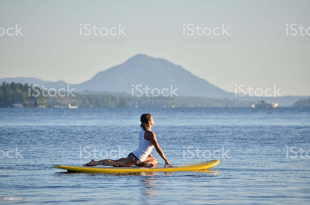 Yoga on a Paddle Board stock photo