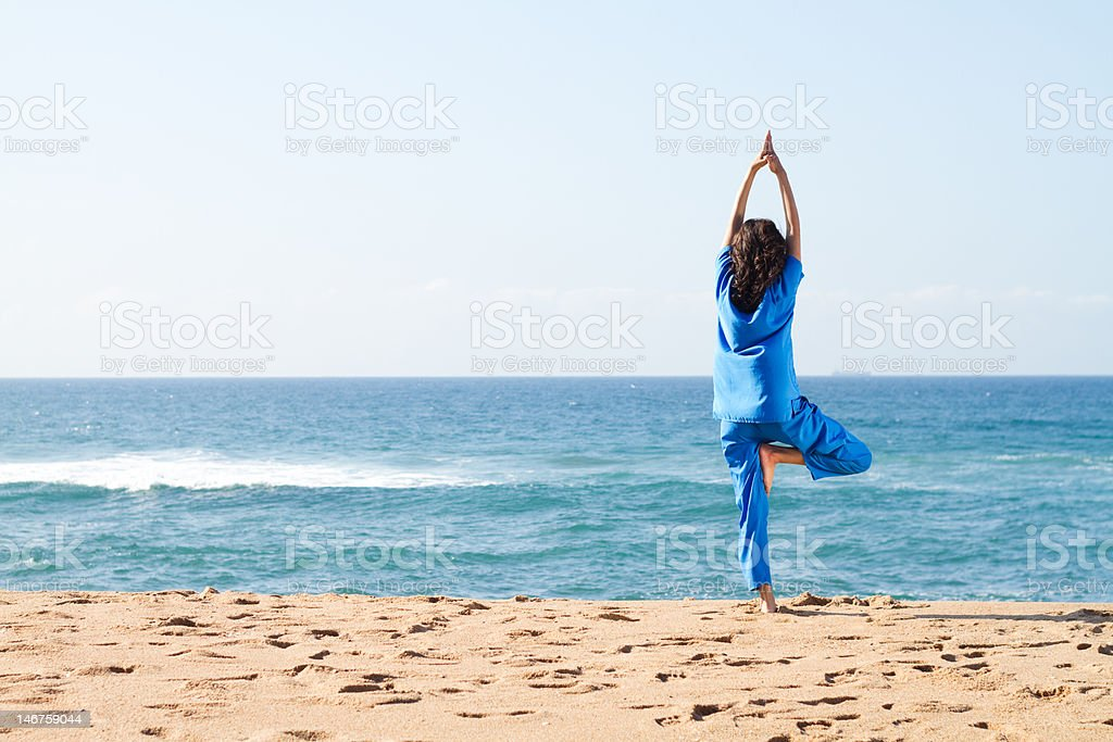 yoga on beach royalty-free stock photo