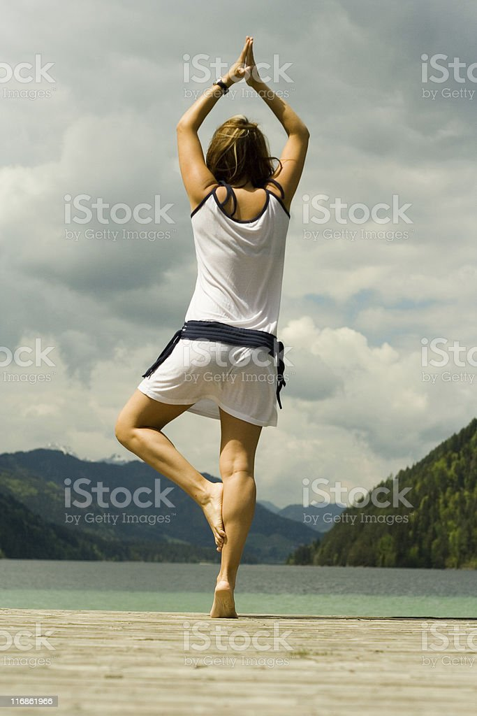 yoga on lake royalty-free stock photo