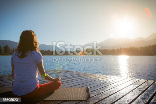 istock Yoga on lake 536059201