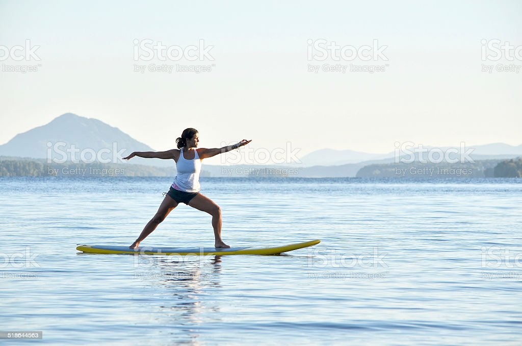Yoga on Stand-Up Paddle Boarding stock photo