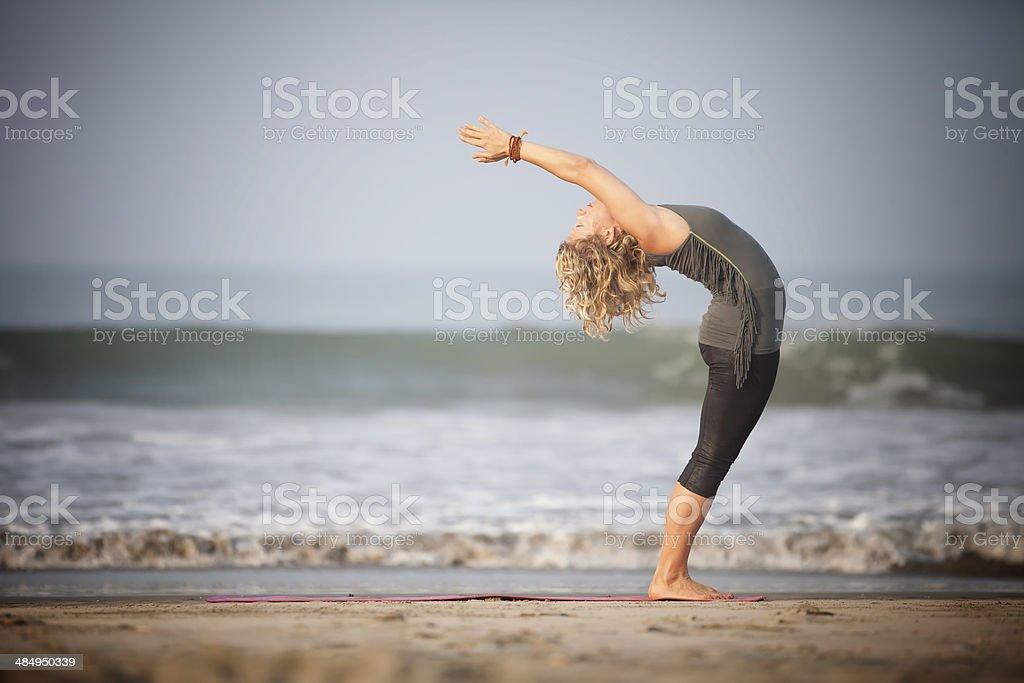 Yoga on the beach. stock photo