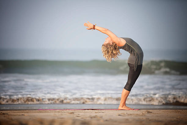 Yoga on the beach. Woman does yoga at the beach of GOA-INDIA bending over backwards stock pictures, royalty-free photos & images