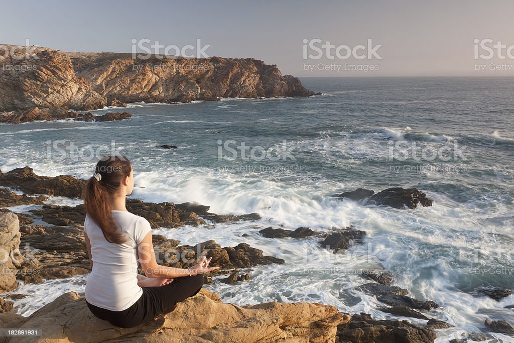 Yoga on the Cliffs stock photo