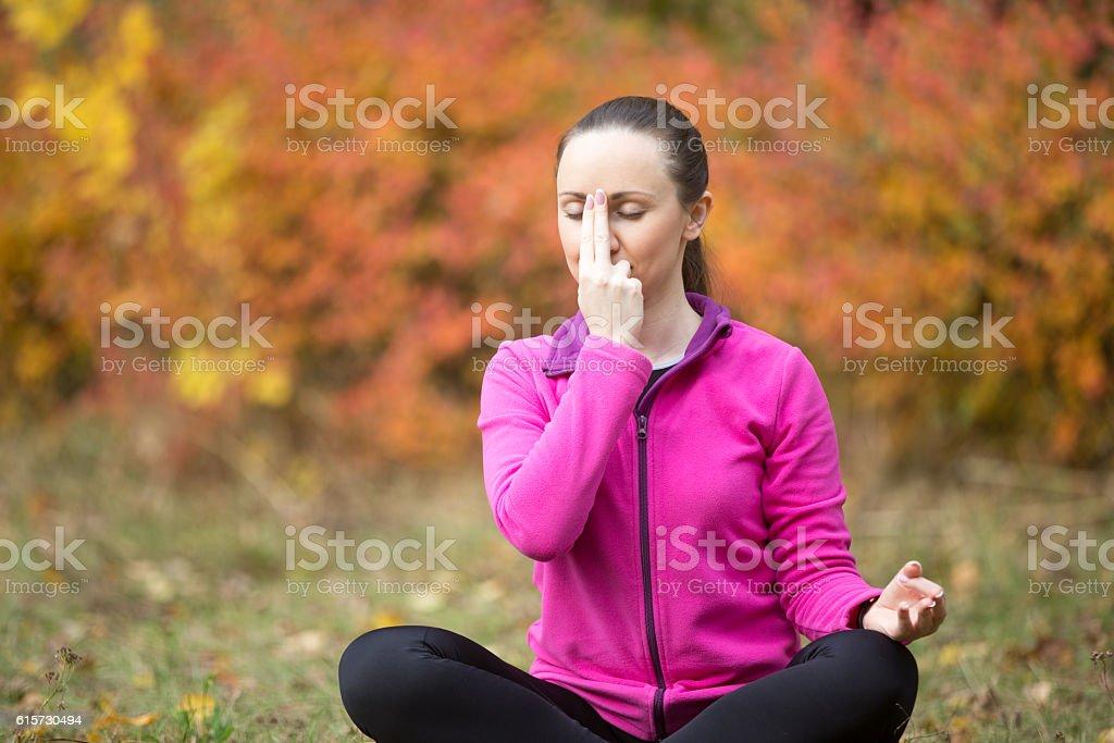 Yoga outdoors: Alternate Nostril Breathing stock photo