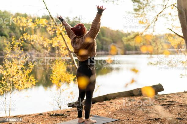 Photo of Yoga Outdoors in an Autumn Forest