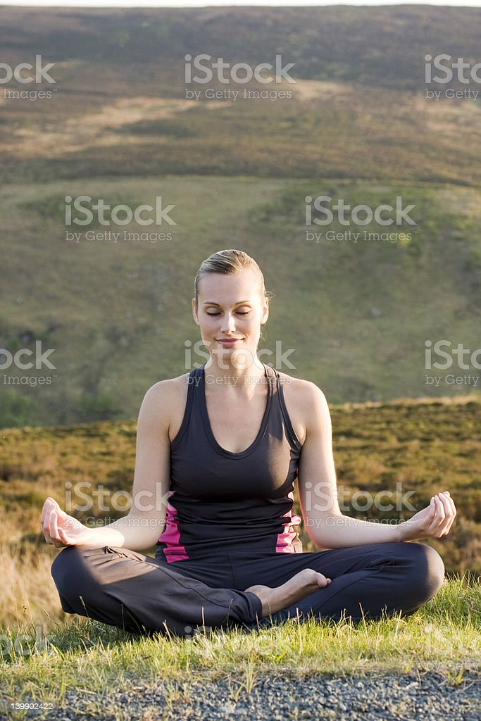 Yoga outside in natural environment royalty-free stock photo