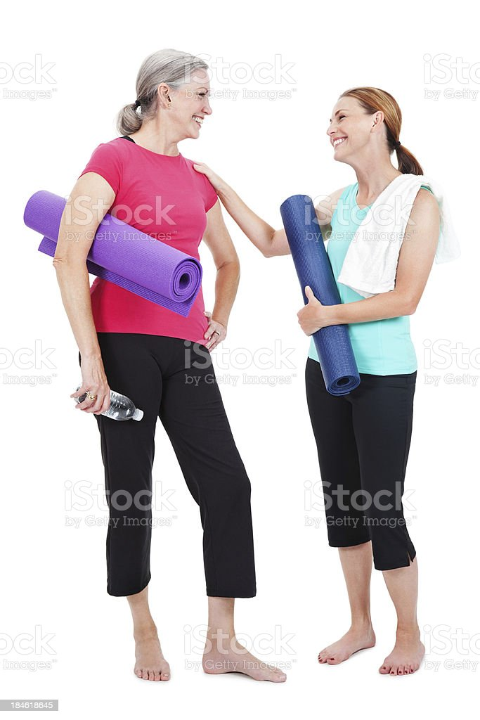 Yoga partners laughing together, isolated on white background royalty-free stock photo