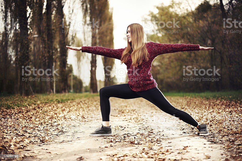 Yoga (Virabhadrasana) royalty-free stock photo