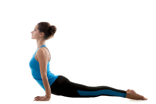 Yoga pose ardha mukha shvanasana Sporty yoga girl on white background in urdhva mukha shvanasana (Upward Facing Dog Pose) upward facing dog position stock pictures, royalty-free photos & images