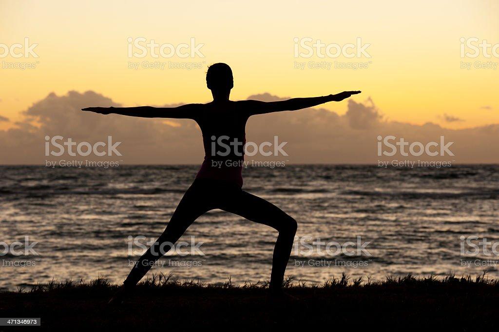 Yoga Pose at Sunrise stock photo