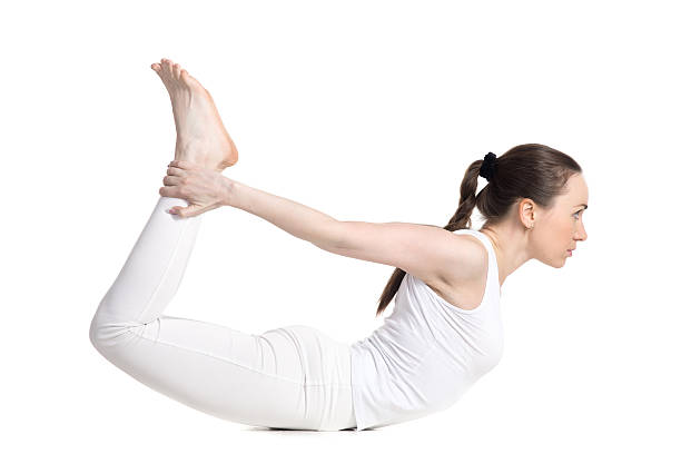 Yoga pose dhanurasana stock photo