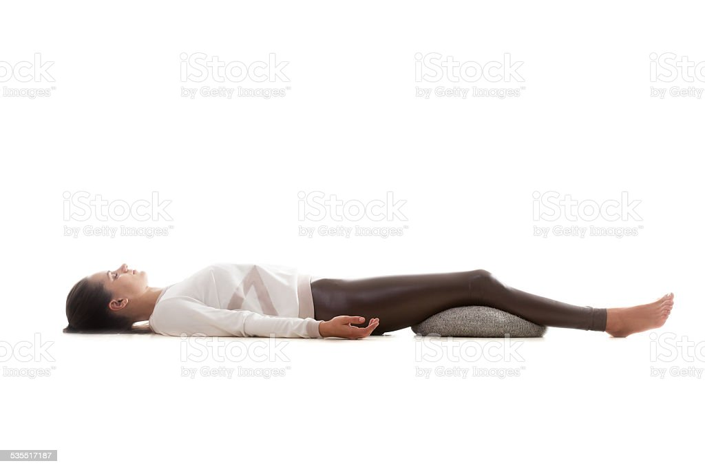 Yoga pose shavasana stock photo