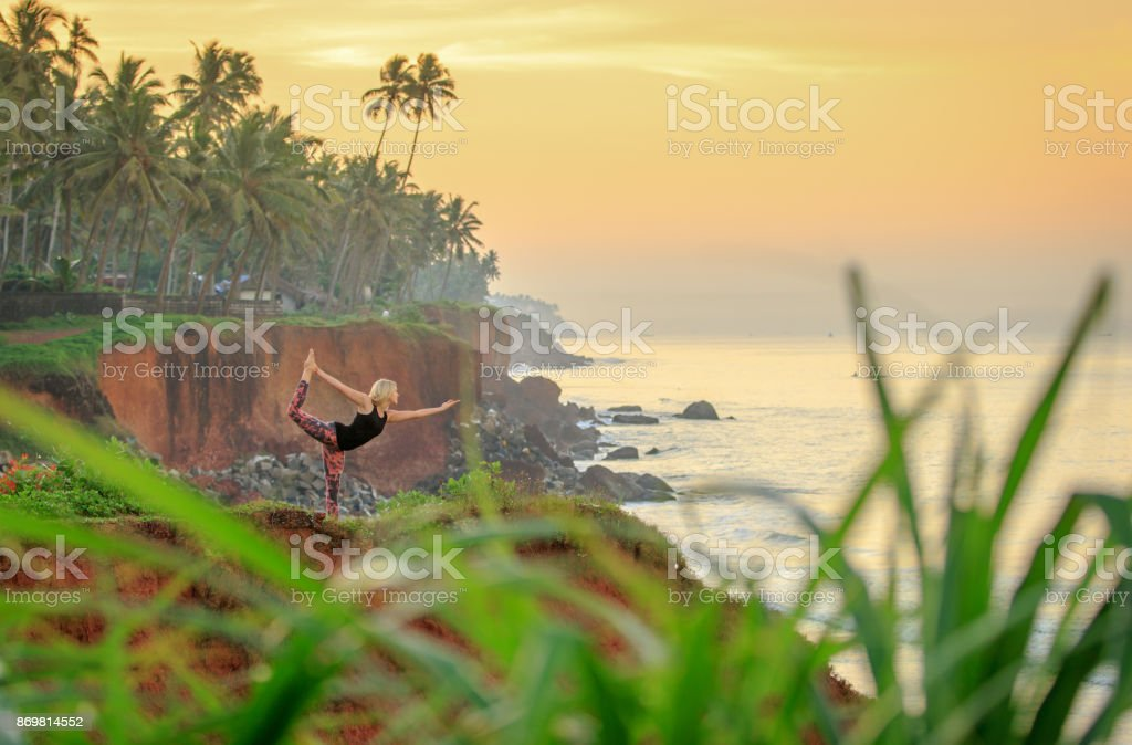 Yoga pose sunrise India stock photo