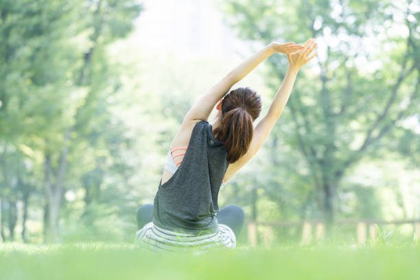 yoga poses at the park - forest bathing foto e immagini stock