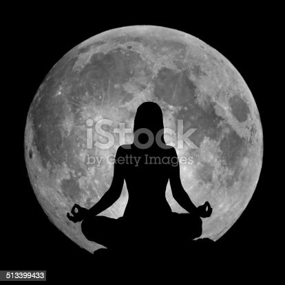 istock Yoga position silhouette against the Moon 513399433
