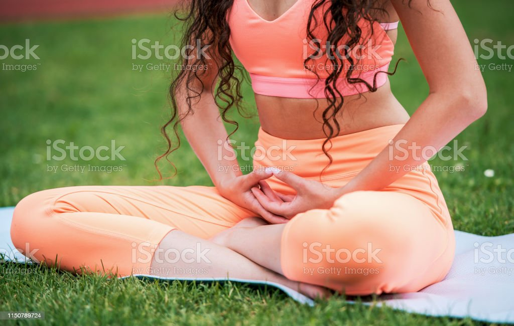 Woman practicing yoga outdoor, close up photo. Sport and recreation,...