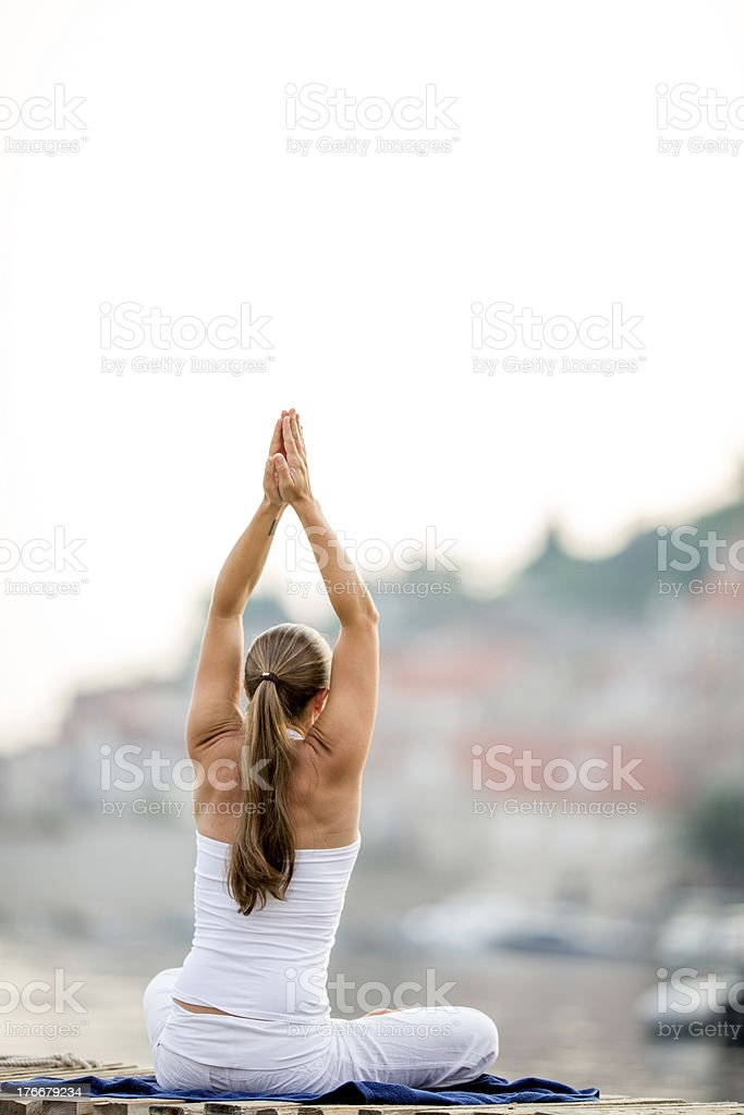 Yoga practicing outdoors royalty-free stock photo