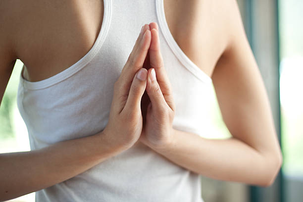 Yoga prayer hands behind back stock photo