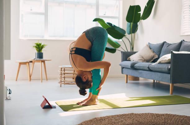 Yoga promotes positive hip hinge movement stock photo