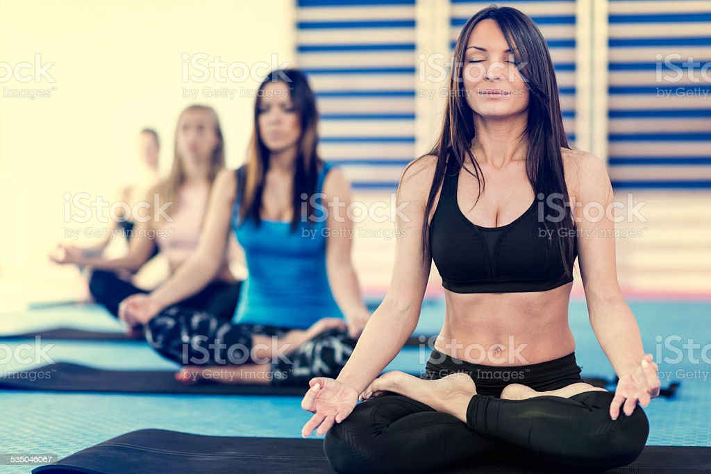 Group of women on yoga class. Toned image