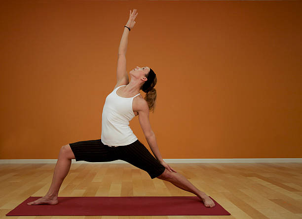 yoga reverse warrior pose with room for text stock photo