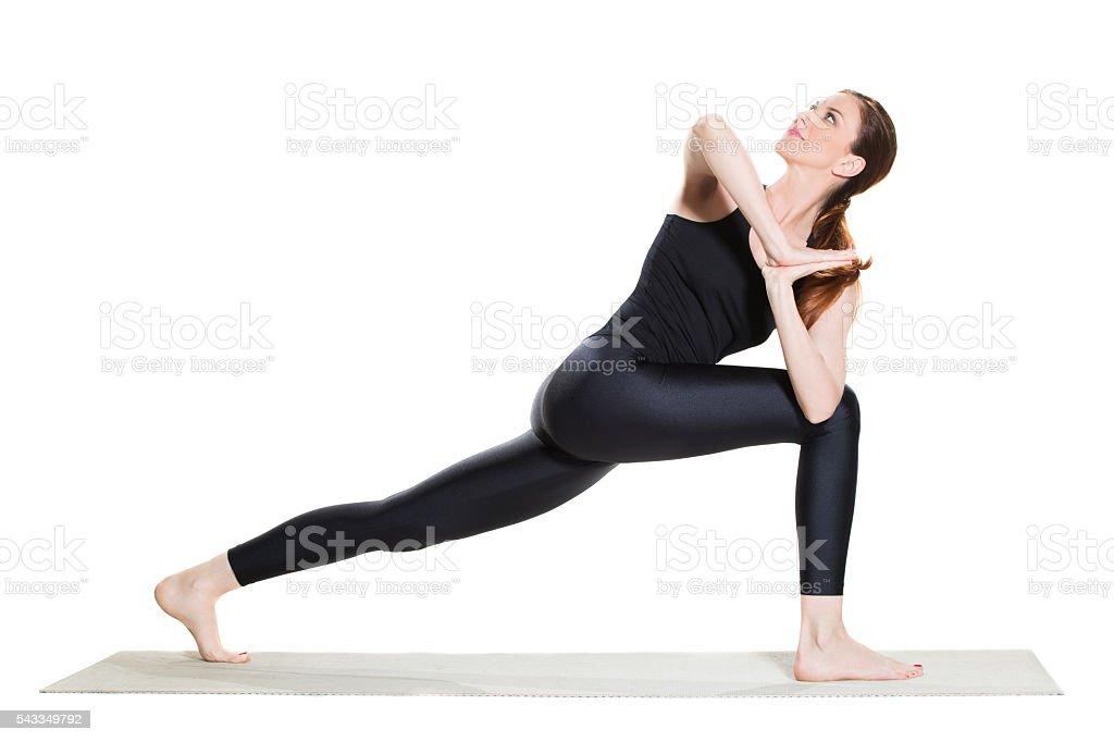 Yoga Revolved Lunge Pose - Parivrtta Anjaneyasana stock photo