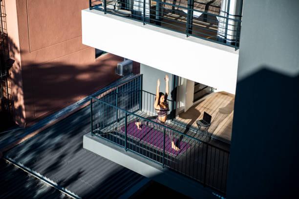 Yoga routine at the balcony. stock photo