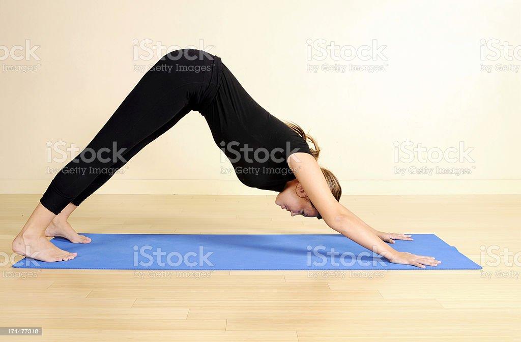 Yoga Series: Downward Facing Dog royalty-free stock photo