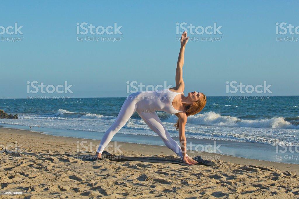 Yoga series on a beach stock photo