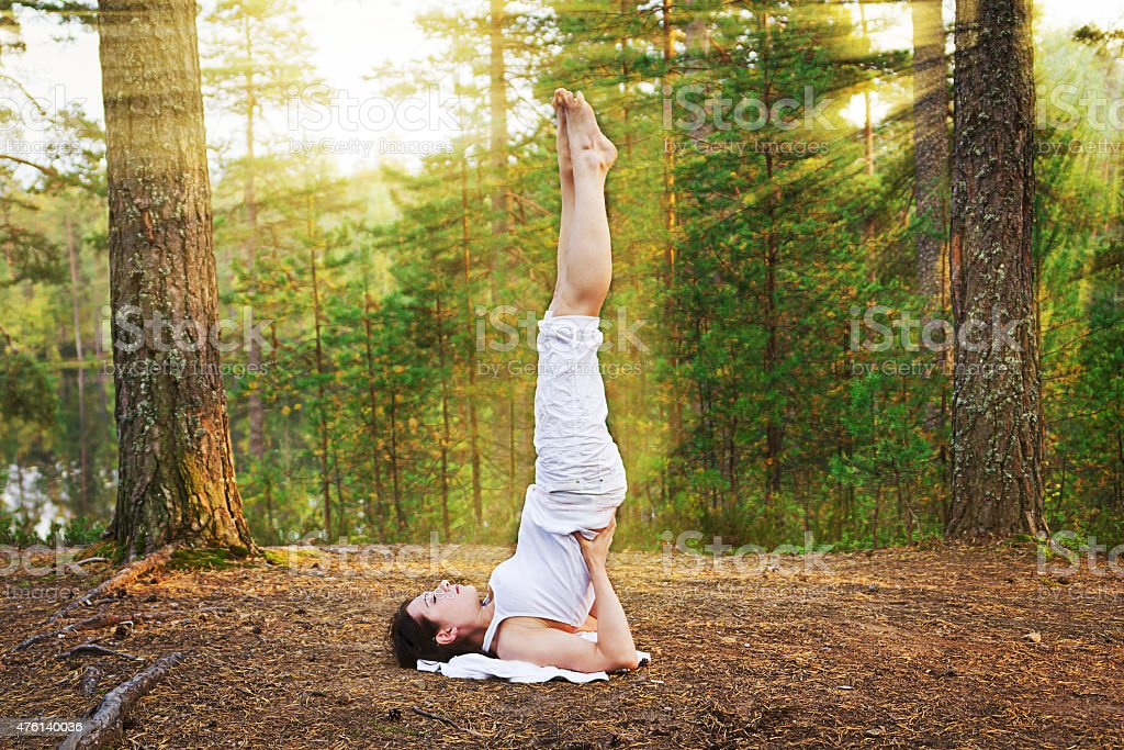 Yoga shoulder stand stock photo